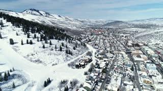 Aerial High Shot Of Beautiful Winter Mountain Resort Town In Utah