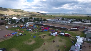 Aerial High Shot Of Families Having Fun At Rural Fair With Rides And Activities