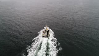 Aerial Of A Fishing Boat Checking Their Lobster Traps In Ocean