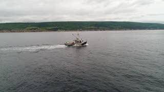 Aerial Of A Large Commercial Ocean Boat Checking Their Lobster Traps