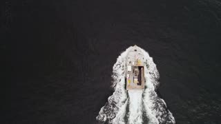 Aerial Of A Large Fishing Boat While Checking Their Lobster Traps In Ocean