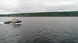 Aerial Of Big Commercial Fishing Boat Checking Their Lobster Traps In Ocean