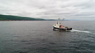 Aerial Of Commercial Fishing Boats Checking Their Lobster Traps In Ocean