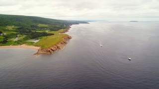 Aerial Of Fishing Boats Checking Their Lobster Traps In Ocean