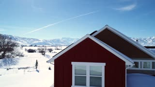 Aerial Of House With Solar Panels During The Winter