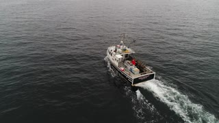 Aerial Of Large Commercial Ocean Boat Checking Their Lobster Traps