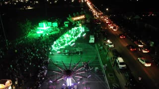 Aerial Of Large Crowds Having Fun At A Small Carnival And Fireworks