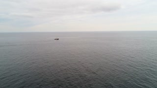 Aerial Of Large Fishing Boat Checking Their Lobster Traps In Ocean