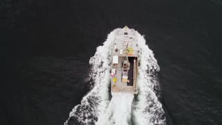Aerial Of Large Fishing Boat While Checking Their Lobster Traps In Ocean