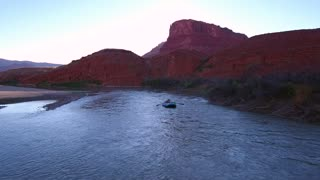 Aerial Of Man Rafting Down The Beautiful Desert Colorado River In Utah