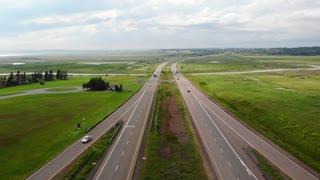 Aerial People Travelling On Long Rural Highway