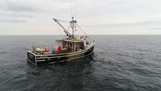 Aerial Shot Commercial Ocean Fishing Boat Checking Lobster Traps