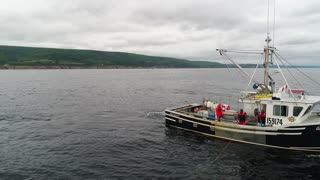 Aerial Shot Of A Commercial Ocean Fishing Boat Fishing With Lobster Traps