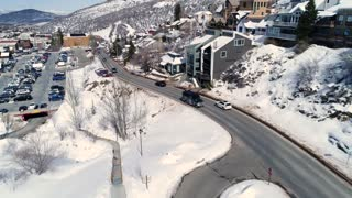 Aerial Shot Of Cars In A Winter Mountain Resort Town In Utah