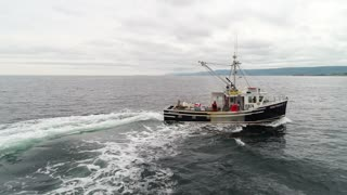 Aerial Shot Of Commercial Ocean Fishing Boat Fishing With Lobster Traps