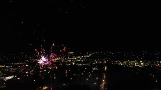 Aerial Shot Of Large Crowd At Fireworks And Carnival