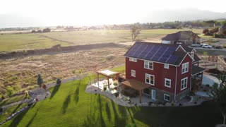 Aerial Shot Of Large Solar Panels On A Rooftop Of A House