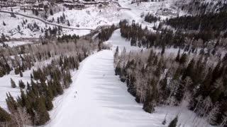 Aerial Shot Of People Downhill Skiing At Beautiful Mountain Ski Resort