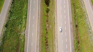 Aerial Shot People Travelling On Long Rural Highway