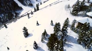 Aerial Tilting Shot Of People Skiing By At Deer Valley