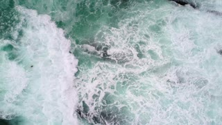 Aerial Wild Ocean Waves Crash On Rocky Coast Rotating