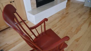 An Empty Rocking Chair In A House High Shot