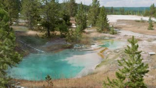 Blue Water Boiling From Natural Hot Pot In Yellowstone National Park
