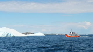 Boat Of Tourists Look At Ice Berg Floating By Twillingate Newfoundland