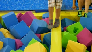 Boys Playing In A Soft Foam Pit At A Jump House