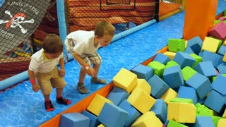 Boys Playing In The Soft Foam Pit In A Jump House