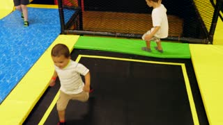 Brothers Playing Together At A Fun Trampoline Bounce House