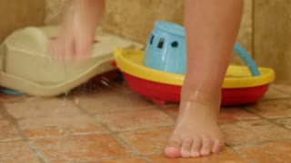 Cute Toddlers Feet In A Shower With Toys