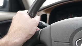 Dashboard And Hand In A Car Driving Fast On Highway
