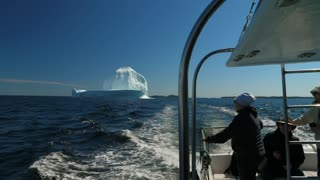 Editorial A Boat Of Tourists Looking At Ice Berg Floating By Twillingate Newfoundland