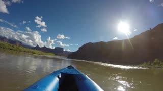 Family In Kayaks On Colorado River Near Moab Utah Desert