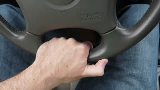 Hand And Steering Wheel In A Car Driving Fast On Highway