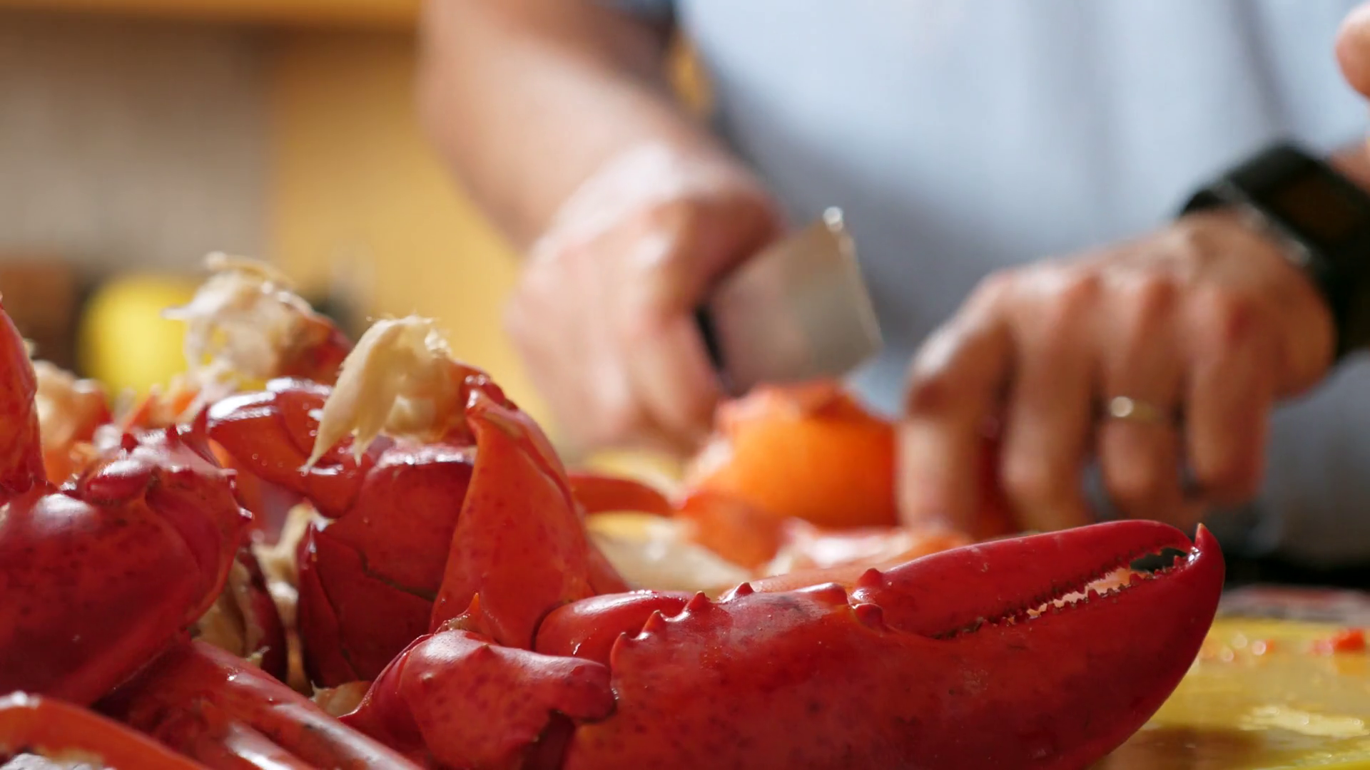 Hands Chop Fresh Boiled Hot Red Lobster ...