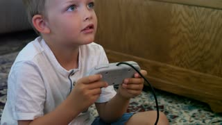 Little Boy Playing With A Video Game Console
