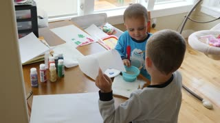 Little Boys Painting Together At Their Craft Table