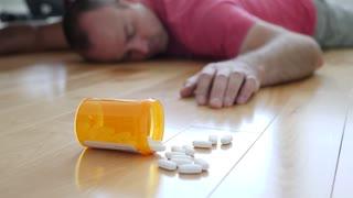 Man Lies On A Floor After Prescription Drug Overdose