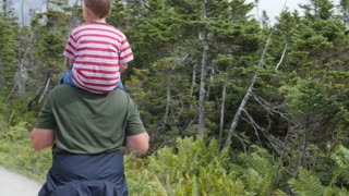 Man With A Boy On Shoulders Hikes The Skyline Trail