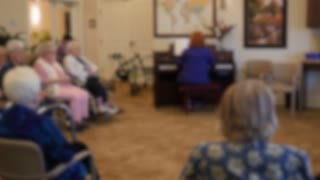 Old People Listen To The Piano In Retirement Home Dolly Shot