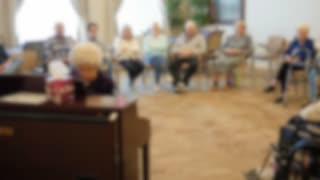 Old People Listening To A Recital In Retirement Home