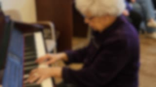 Old People Listening To Piano Playing In Retirement Home Out Of Focus