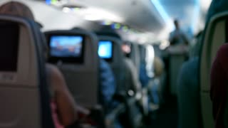 People Ride On A Bumpy Airplane Out Of Focus