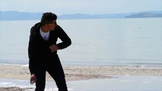 Slow Motion A Mexican Man Skips Stones In The Water