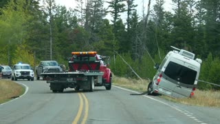 Slow Motion As Tow Truck Helps Van That Crashed