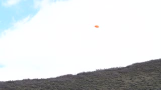 Slow Motion Clay Pigeon Explodes When Shot With Shotgun