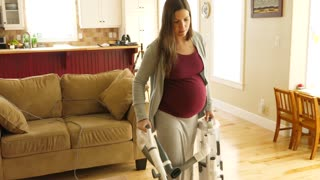 Slow Motion Of A Pregnant Woman Vacuuming The Floor