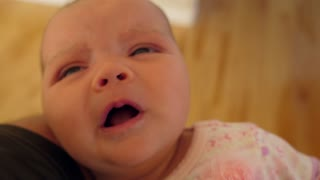 Slow Motion Of Cute Baby Girl Screaming In Her Parents Arms